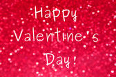 Happy Valentine's Day greeting over bright and abstract blurred pink background with shimmering glitter — Fotografia Stock
