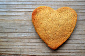 Gingerbread cookies in shape of heart on wooden table — Stock Photo
