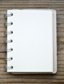 An empty retro spiral notebook with old paper — ストック写真