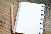 An empty retro notebook with old paper and little pencil — Fotografia Stock
