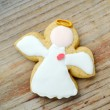 Gingerbread in a shape of heart and angel with pink and white icing and little cute ballet dancer on wooden table — Stock Photo #66002263