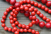 Traditional Ukrainian round red bead made from wood — Stock Photo