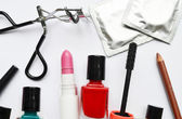 Couple of condoms and a cosmetics set with black mascara, pink and red nail polish and lipstick and eyelash curler isolated on white — 图库照片