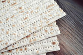 Traditional jewish bread matzo on wooden table — Stock Photo