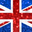 The National flag of the United Kingdom of Great Britain and Northern Ireland, commonly known as the Union Jack or Union Flag, made of bright and abstract blurred backgrounds with shimmering glitter — Stock Photo #69724855