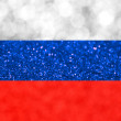 The National flag of the Russian Federation made of bright and abstract blurred backgrounds with shimmering glitter — Stock Photo #69849629