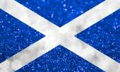 The National flag of Scotland made of bright and abstract blurred backgrounds with shimmering glitter — Stock Photo
