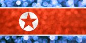 The National flag of Democratic People's Republic of Korea made of bright and abstract blurred backgrounds with shimmering glitter — Stock Photo