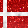 The National flag of Denmark made of bright and abstract blurred backgrounds with shimmering glitter — Stock Photo #70251109
