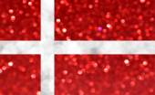 The National flag of Denmark made of bright and abstract blurred backgrounds with shimmering glitter — Stock Photo