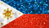 Three Stars and a Sun - the National flag of the Philippines made of bright and abstract blurred backgrounds with shimmering glitter — Stok fotoğraf