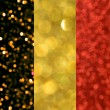 The National flag of the Kingdom of Belgium made of bright and abstract blurred backgrounds with shimmering glitter — Stock Photo #70664053