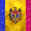 The National flag of the Republic of Moldova made of bright and abstract blurred backgrounds with shimmering glitter — Stock Photo #70664127