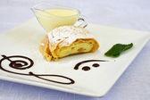 Apple strudel with vanilla cream and mint — Stock Photo