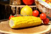 Grilled corn and cherry tomatoes — Stock Photo