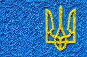 The ukrainian trident in national yellow and blue colours - a symbol of Ukraine — Stock Photo