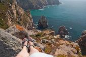 Woman legs on rocks — Stock Photo