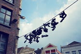 Filtered Picutre of Shoes Hanging from Wire — Stock Photo