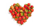 Heart-shaped group of strawberries — Stock Photo
