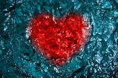 Heart symbol on rippled water texture — Stock Photo
