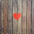 Red heart symbol on the wooden texture — Foto de Stock   #66660477
