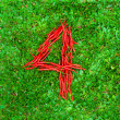 """""""4"""" symbol shaped group of red chili peppers — Stock Photo #66661397"""