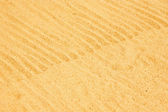 Rippled wavy beach sand — Stock Photo
