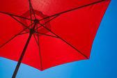 Red sunshade umbrella — Stock Photo