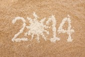 """""""2014"""" text on the sand — Stock Photo"""