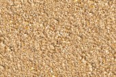 Grainy yellow sand texture — Stock Photo