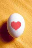 White egg with red heart — Stock Photo