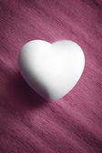 White egg in a heart shape — Stock Photo
