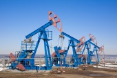 Oil pump and sky — Stock Photo