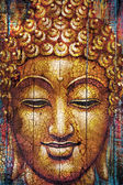 Buddha face on wooden planks — Stock Photo