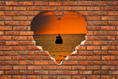 Brick wall shaped as a heart — Stock Photo