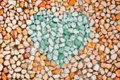 Pebblestone texture with a heart — Stock Photo