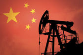 Oil pump with flag of China — Stock Photo
