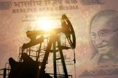 Oil pump with india banknote — Stock Photo