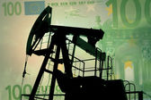 Oil pump with euro banknote — Stock Photo