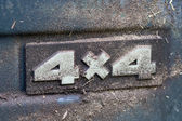 Dirty label of four-wheel drive — Stock Photo