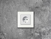 White electric socket on wall — Stock Photo