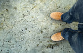 Yellow boots on the road — Stock Photo