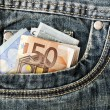 Banknotes in your pocket, euros in jeans. — Stock Photo #60367321