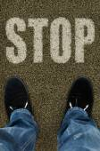 Man on a tarmac road with the word Stop — Stock Photo