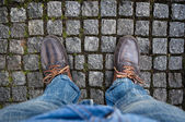 Brown boots on the road — Stock Photo