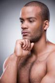 African man holding hand on chin — Stock Photo