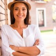 Woman in hat keeping arms crossed — Stock Photo #51932433