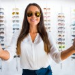 Woman in sunglasses showing  thumbs up — Stock Photo #51932735