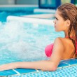 Woman in bikini relaxing in jacuzzi — Stock Photo #52055989