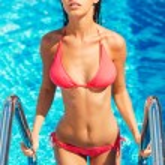 Woman in bikini getting out from the pool — Stock Photo #52056067